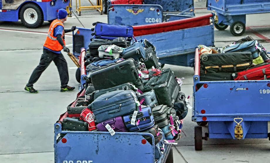 Once free, checked bags bring in a huge amount of money for airlines. Photo: Jim Glab