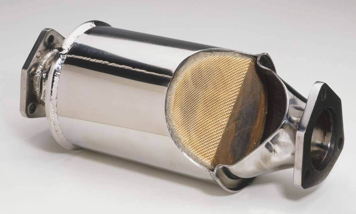 A cutaway catalytic converter from a car's exhaust system.