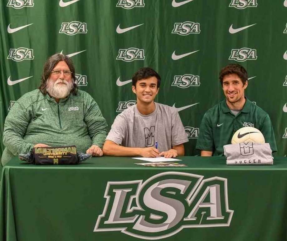 Noa Miller of Lutheran South Academy has signed a track and field letter of intent with Multnomah University. Miller, son of Jason and Desiree Miller, is pictured with LSA coaches Gene Benson and Nate Hagge. Photo: Submitted Photo