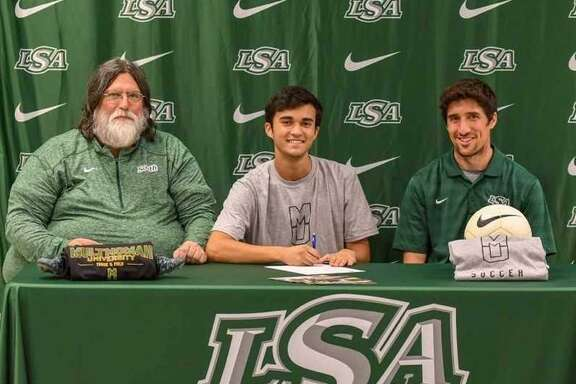Noa Miller of Lutheran South Academy has signed a track and field letter of intent with Multnomah University. Miller, son of Jason and Desiree Miller, is pictured with LSA coaches Gene Benson and Nate Hagge.