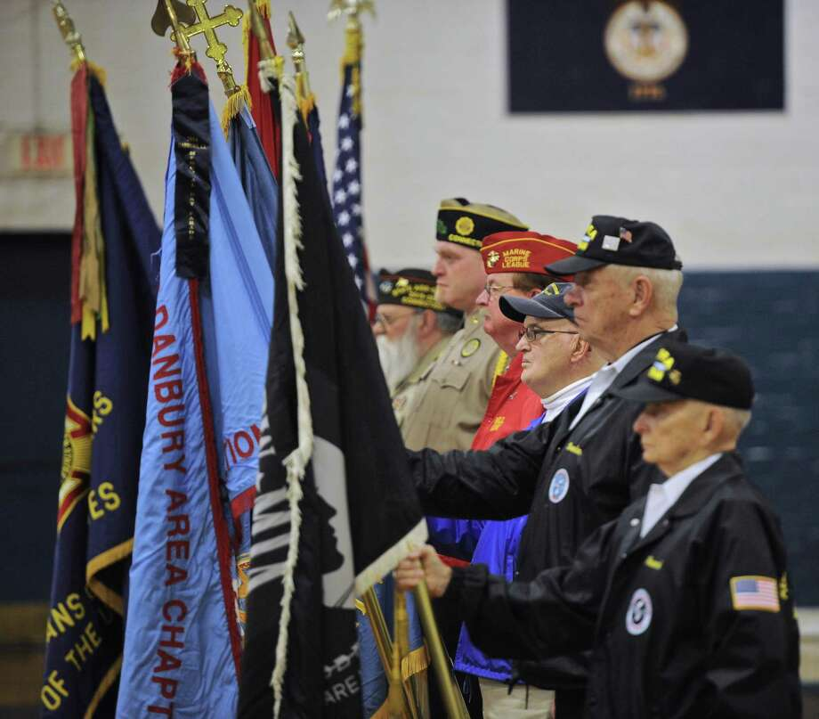 The color guard for the annual Pearl Harbor Memorial Service at the Danbury War Memorial. Wednesday, December 7, 2016, in Danbury, Conn. The Marine Corps League Hat City Detachment hosted the service. Wednesday, December 7, 2016, in Danbury, Conn. Photo: H John Voorhees III / Hearst Connecticut Media / The News-Times