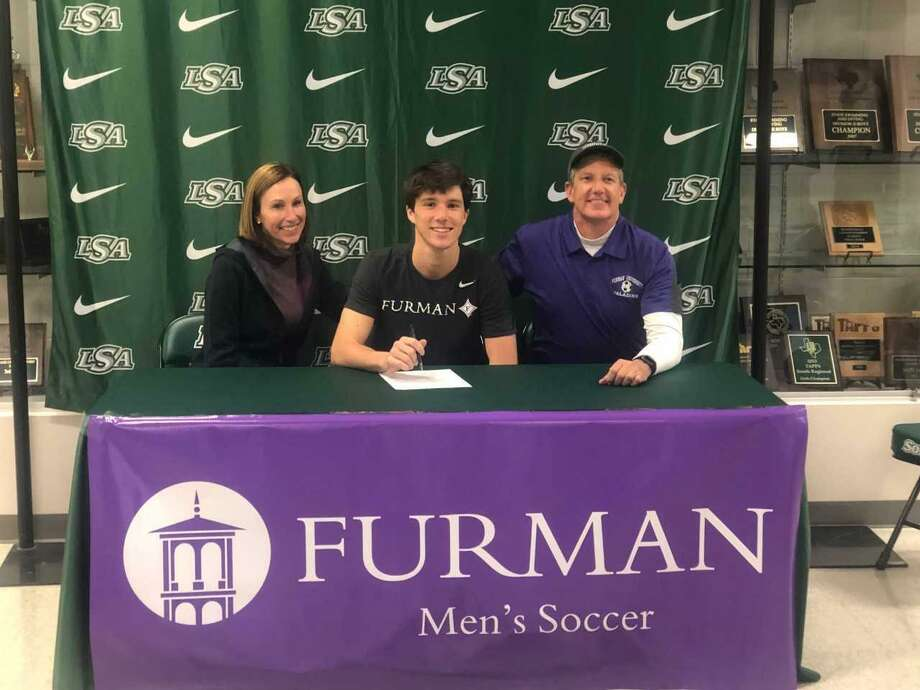 Ben Roberts of Lutheran South University has signed a national soccer letter of intent with Furman University. Roberts is shown with his parents, Brooke and Louie. Photo: Submitted Photo