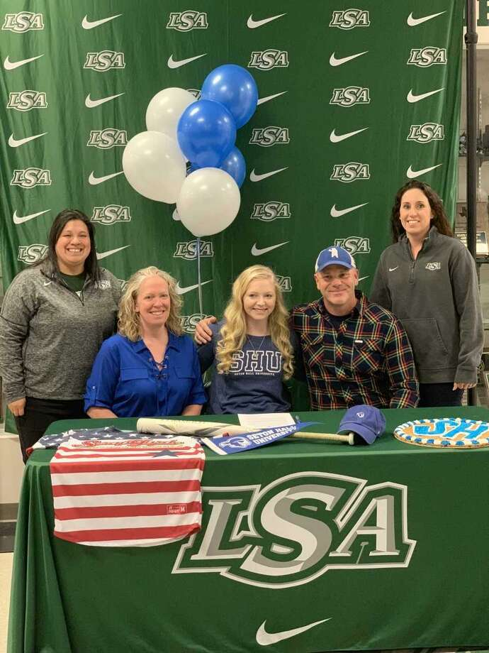 Shelby Smith of Lutheran South Academy has signed a national softball letter of intent with Seton Hall. Smith is shown with LSA coaches Nicole Andrade, parents Shana and James Smith, and LSA coach Leah Jones. Photo: Submitted Photo