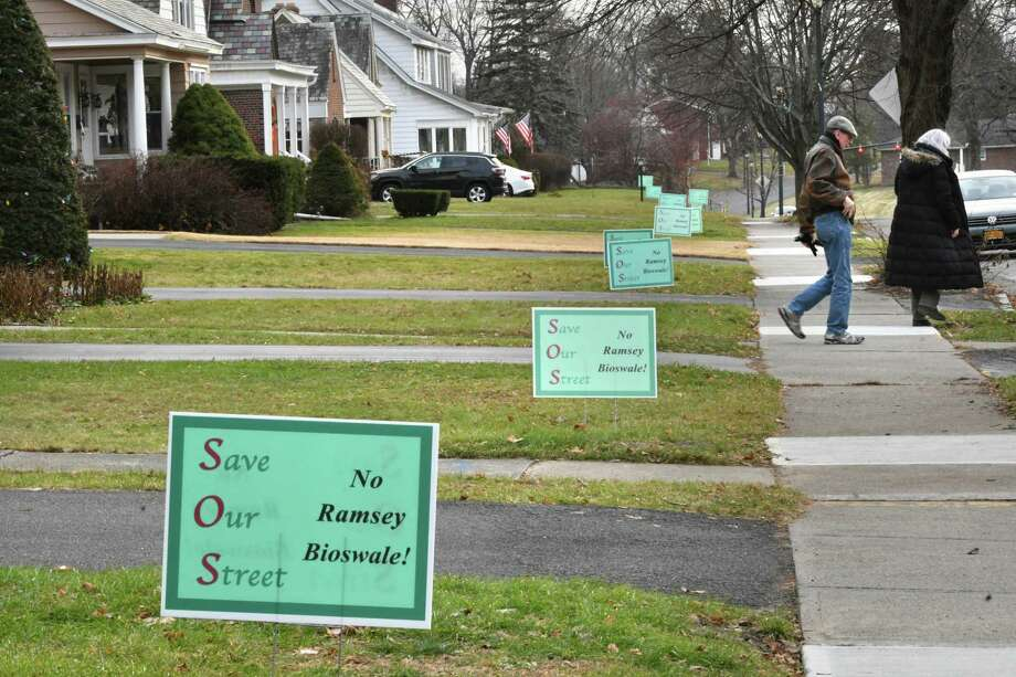 """""""Save Our Street, No Ramsey Bioswale!"""" signs are seen in front of homes along Ramsey Place on Wednesday, Dec. 5, 2018 in Albany, N.Y. (Lori Van Buren/Times Union) Photo: Lori Van Buren, Albany Times Union / 20045646A"""