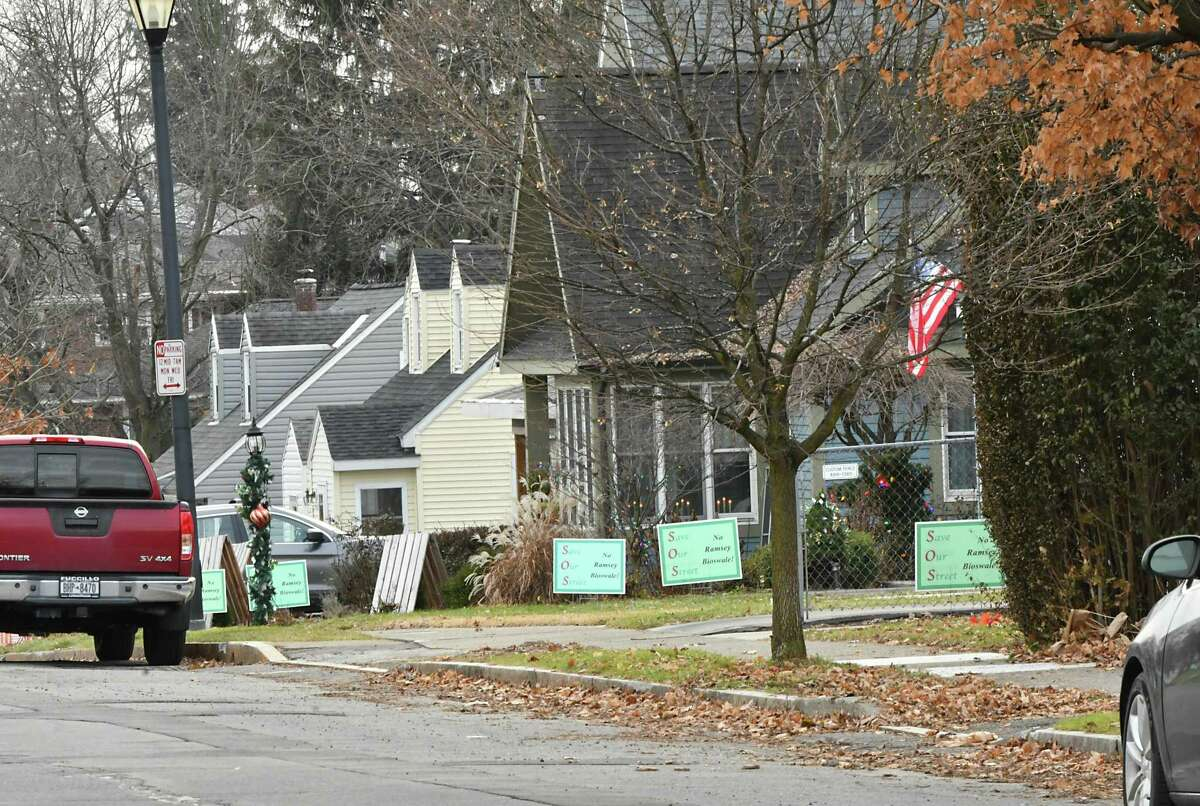 """""""Save Our Street, No Ramsey Bioswale!"""" signs are seen in front of homes along Ramsey Place on Wednesday, Dec. 5, 2018 in Albany, N.Y. (Lori Van Buren/Times Union)"""
