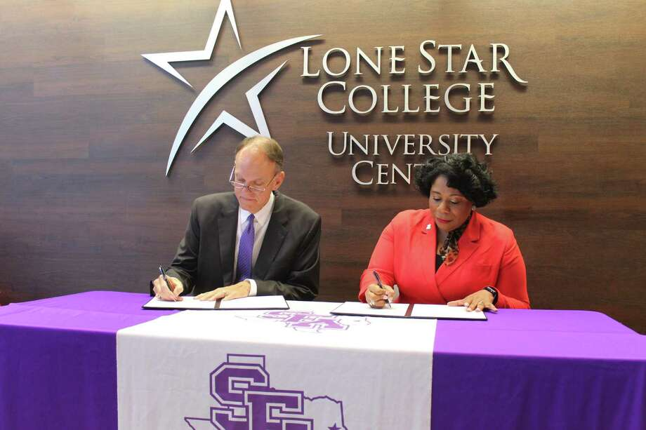 Lone Star College students who receive a Promise scholarship during their first two years are eligible to receive a matching scholarship if they transfer to Stephen F. Austin State University for their final two years of schooling. Here, SFA Acting President and Vice President for University Affairs Steve Westbrook and LSC Executive Vice Chancellor for Student Success Alicia Harvey-Smith sign a collaboration paper. Photo: Jane Stueckemann/The Villager / Photographs By Jane Stueckemann