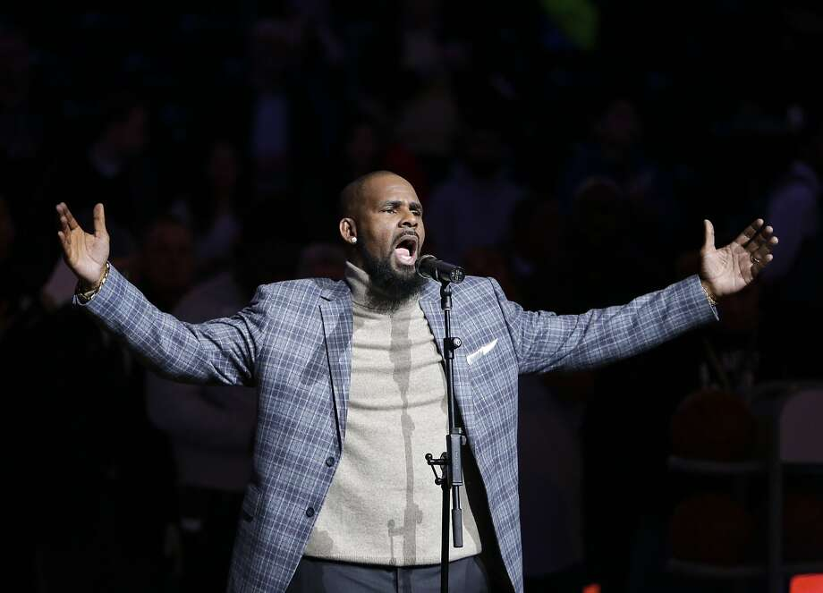 "FILE - In this Nov. 17, 2015, file photo, musical artist R. Kelly performs the national anthem before an NBA basketball game between the Brooklyn Nets and the Atlanta Hawks in New York. A screening of an upcoming documentary detailing abuse allegations against singer R. Kelly was evacuated after phone threats were made to the Manhattan location where it was being held. The New York Police Department says the threats to the NeueHouse Madison Square came in Tuesday night, Dec. 4, 2018, when it was hosting a screening of Lifetime's ""Surviving R. Kelly"" series. (AP Photo/Frank Franklin II, File) Photo: Frank Franklin II, Associated Press"