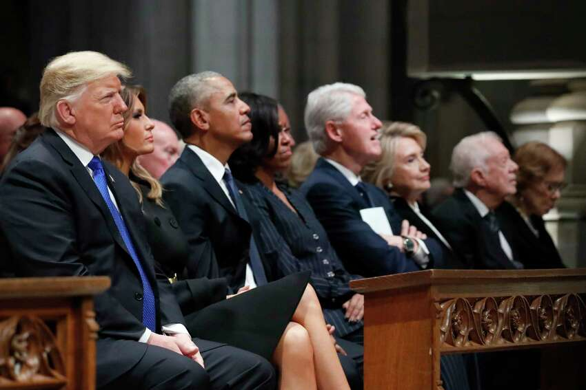 From left, President Donald Trump, first lady Melania Trump, former President Barack Obama, Michelle Obama, former President Bill Clinton, former Secretary of State Hillary Clinton, and former President Jimmy Carter listen as former President George W. Bush speaks during a State Funeral at the National Cathedral, Wednesday, Dec. 5, 2018, in Washington, for former President George H.W. Bush.