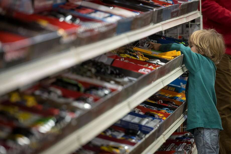 A child checks out the toy cars at Talbot's Toyland in San Mateo. the store is using a device that records bar codes scanned at the register to compile a digital inventory posted in Google searches. Photo: Photos By David Paul Morris / Bloomberg