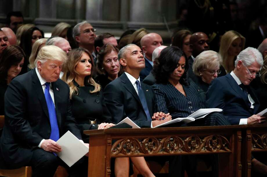 From left, President Donald Trump, first lady Melania Trump, former President Barack Obama, Michelle Obama, and former President Bill Clinton listen during a State Funeral at the National Cathedral, Wednesday, Dec. 5, 2018, in Washington, for former President George H.W. Bush. Photo: Alex Brandon, AP / Copyright 2018 The Associated Press. All rights reserved.