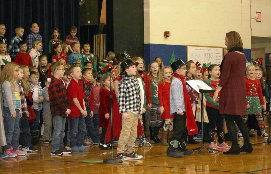 Jumping into the Christmas spirit, Bad Axe Elementary students treated their family and friends to a special concert Wednesday morning. After many weeks of practicing, students — donning unique Christmas attire — showed off their skills and performed popular holiday tunes. Photo: Bradley Massman/Huron Daily Tribune