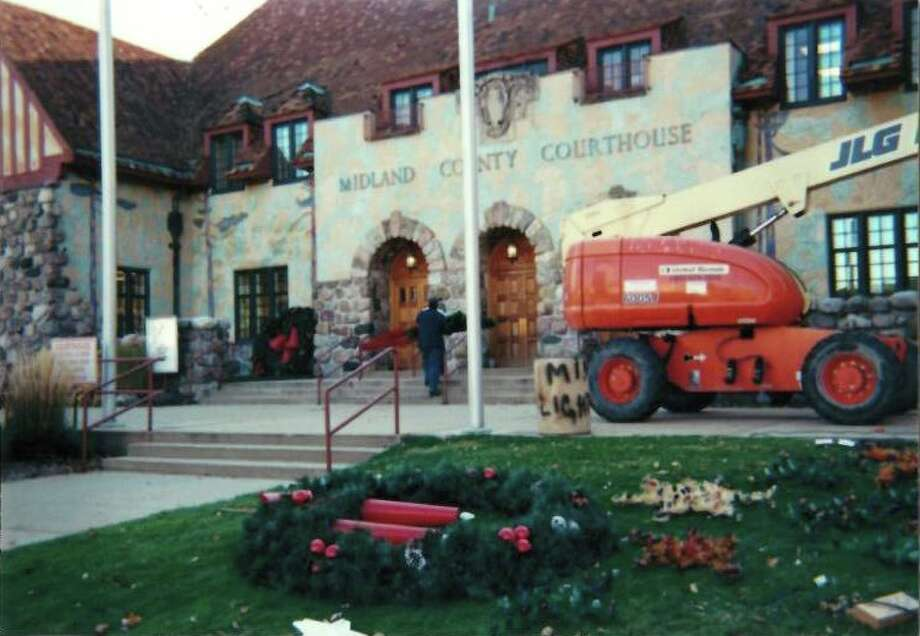 Gerace Construction workers set up Christmas decorations in front of the Midland County Courthouse and Santa House. Photos are from 2003. Photo: Photos Provided By Tom Valent