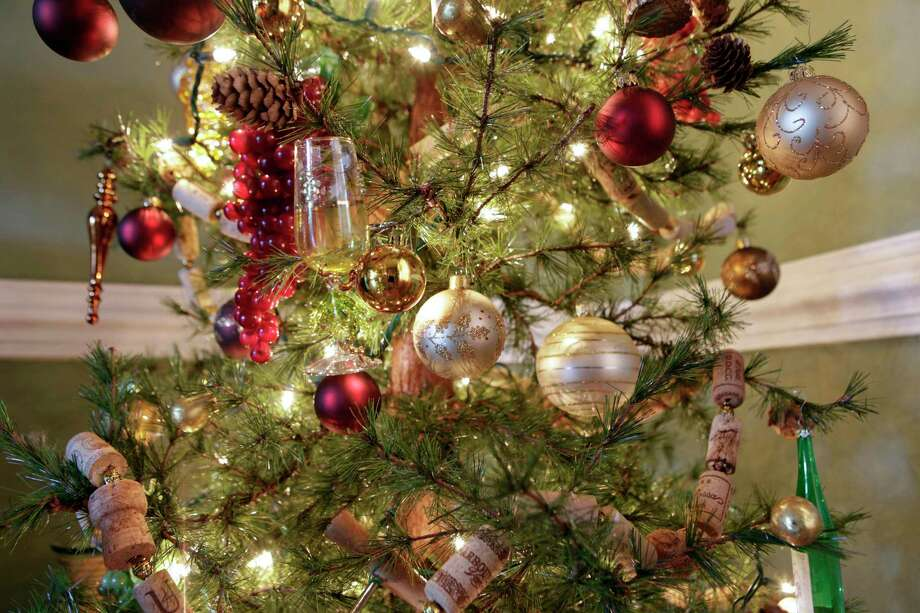 A Christmas tree decorated with wine-related items. Photo: JAY PAUL, STR / New York Times / NYTNS