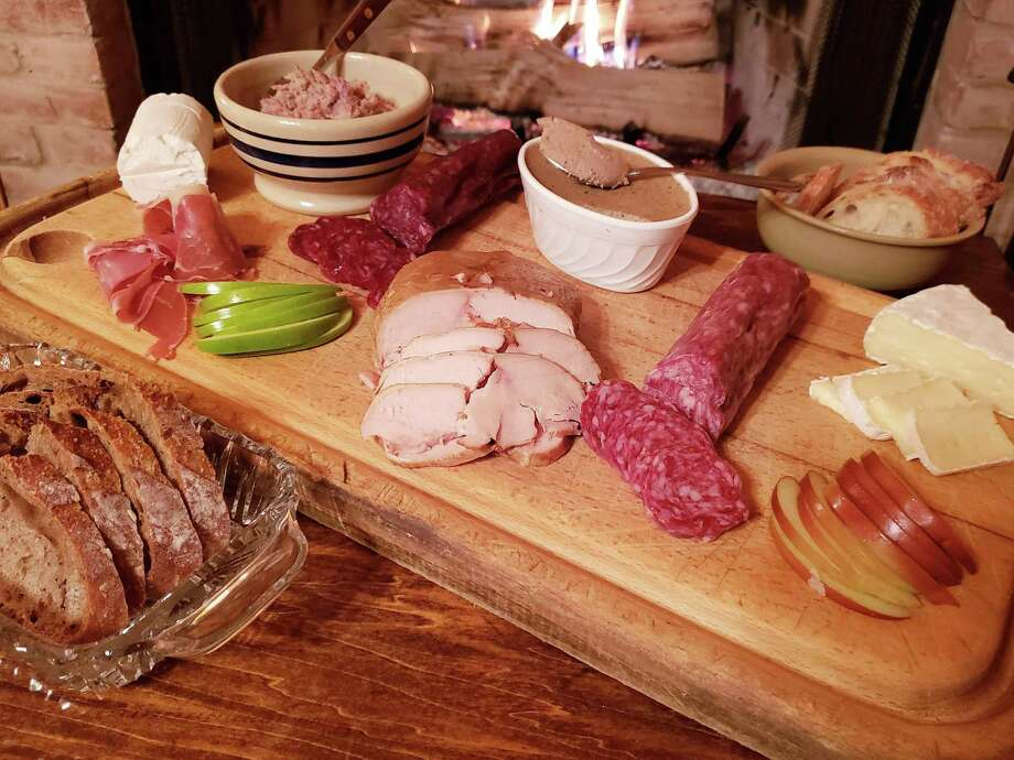 A charcuterie and cheese board makes a great presentation for holiday parties. Photo: Frank Whitman / For Hearst Connecticut Media / Norwalk Hour freelance