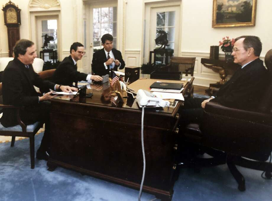 Dan Freedman (seated center, left) was part of a team of Hearst journalists who interviewed President George HW Bush in 1992. Photo: The White House / Contributed Photo / Connecticut Post Contributed