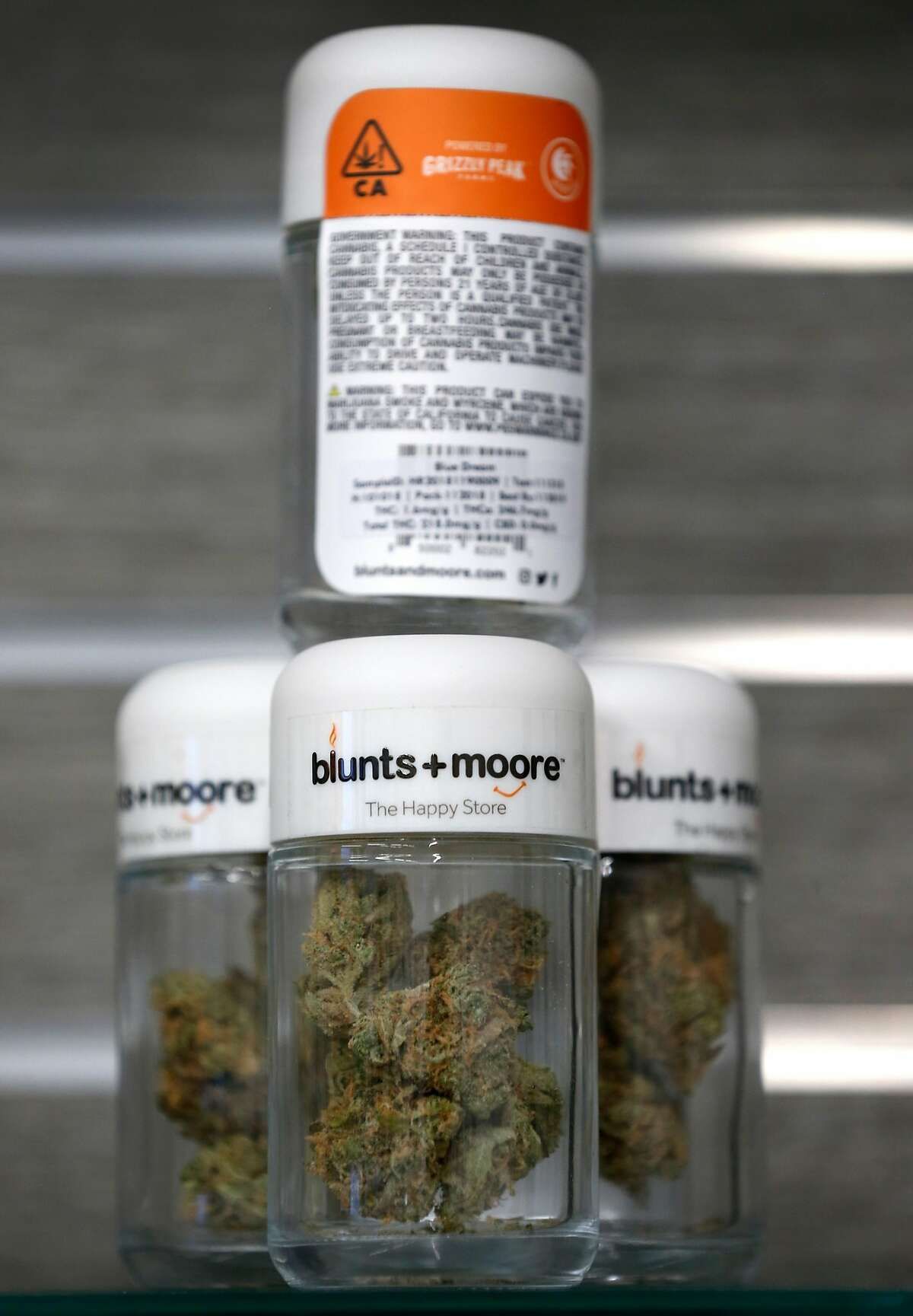 Product is displayed on a shelf at the Blunts + Moore cannabis dispensary in Oakland, Calif. on Thursday, Nov. 29, 2018, the first dispensary to open through the city's cannabis equity program.