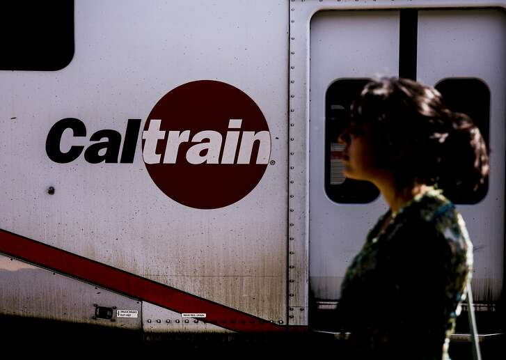 Odalys Vallejo is silhouetted against a train at the CalTrain Station near 4th and King streets in San Francisco, Calif. Wednesday, Aug. 29, 2018.