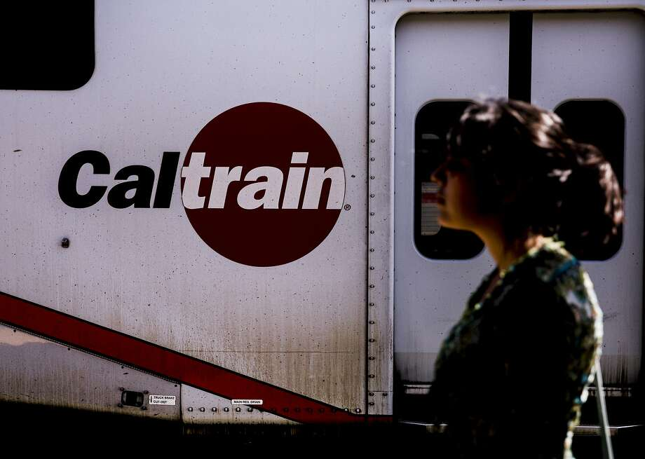 Odalys Vallejo is silhouetted against a train at the CalTrain Station near 4th and King streets in San Francisco, Calif. Wednesday, Aug. 29, 2018. Photo: Jessica Christian / The Chronicle