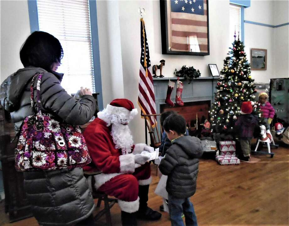 Santa will stop by the Brookfield Museum for the Traditional Christmas Open House, which will be held from noon to 4 p.m. Saturday and Sunday. Photo: / Contributed Photo / Copyright 2009