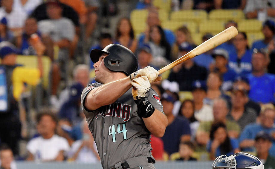 FILE - In this Aug. 31, 2018 file photo Arizona Diamondbacks' Paul Goldschmidt hits a two-run home run during the first inning of a baseball game against the Los Angeles Dodgers in Los Angeles. The St. Louis Cardinals have acquired Goldschmidt from the Diamondbacks in a multiplayer trade. The Cardinals sent pitcher Luke Weaver, catcher Carson Kelly, minor league infielder Andy Young and a 2019 draft pick to Arizona in the deal Wednesday, Dec. 5, 2018. (AP Photo/Mark J. Terrill) Photo: Mark J. Terrill, Associated Press / Copyright 2018 The Associated Press. All rights reserved.