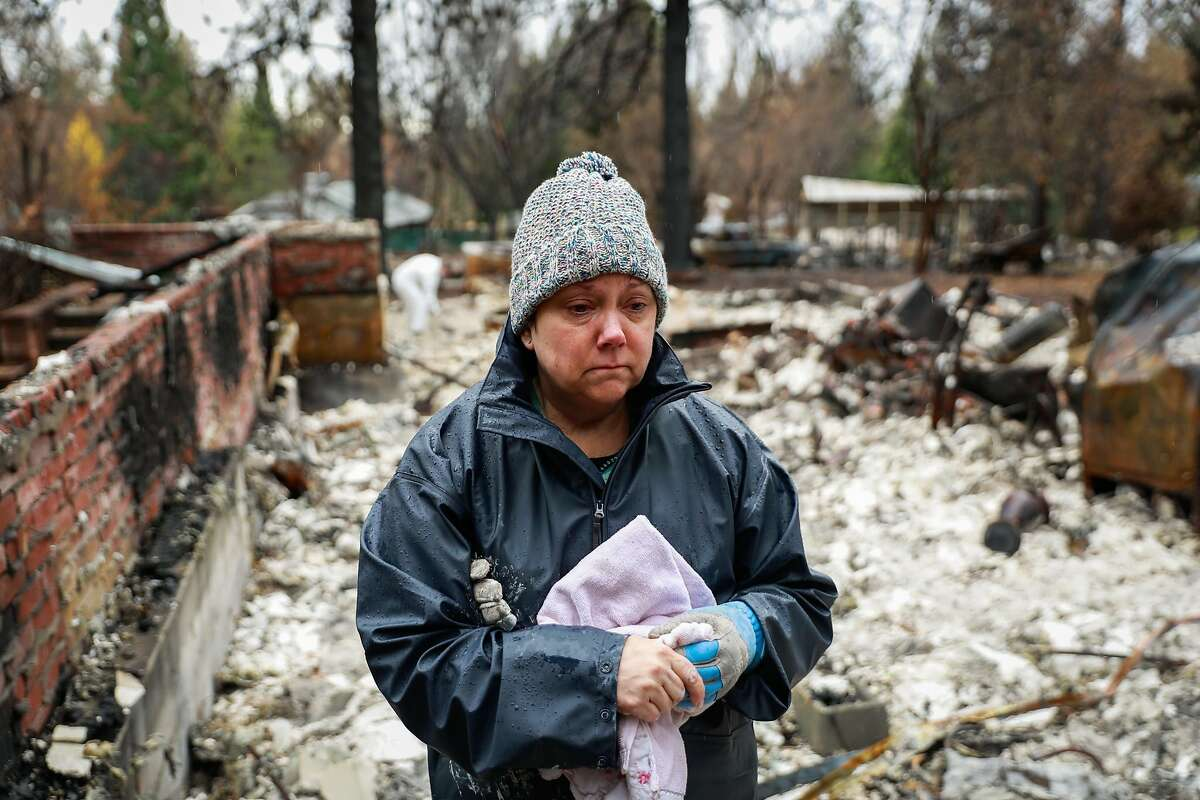 Julie Skelley,55 gets emotional while looking at her property which was destroyed by the Camp Fire in Paradise, California, on Wednesday, Dec. 5, 2018. The area off of Pentz Road had its evacuation order lifted today.