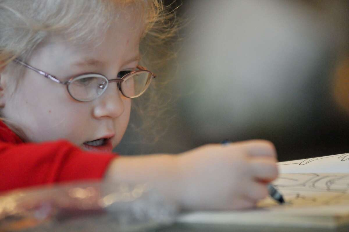 Leighton Metzger, 4, works on a Christmas art project at Respite Care of San Antonio in 2012. There are many nonprofits that can benefit from San Antonio philanthropy.