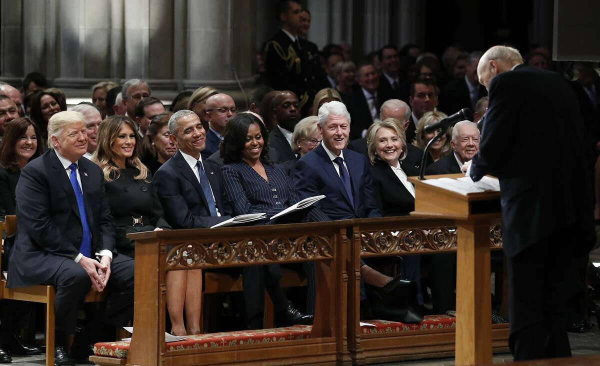 From left, President Donald Trump, first lady Melania Trump, former President Barack Obama, Michelle Obama, former President Bill Clinton, former Secretary of State Hillary Clinton, and former President Jimmy Carter listen as former Sen. Alan Simpson, R-Wyo., speaks during a State Funeral at the National Cathedral, Wednesday, Dec. 5, 2018, in Washington, for former President George H.W. Bush. In the second row are Vice President Mike Pence and Karen Pence.