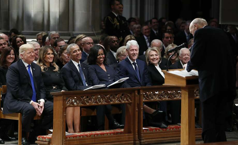 From left, President Donald Trump, first lady Melania Trump, former President Barack Obama, Michelle Obama, former President Bill Clinton, former Secretary of State Hillary Clinton, and former President Jimmy Carter listen as former Sen. Alan Simpson, R-Wyo., speaks during a State Funeral at the National Cathedral, Wednesday, Dec. 5, 2018, in Washington, for former President George H.W. Bush. In the second row are Vice President Mike Pence and Karen Pence. Photo: Alex Brandon, Associated Press