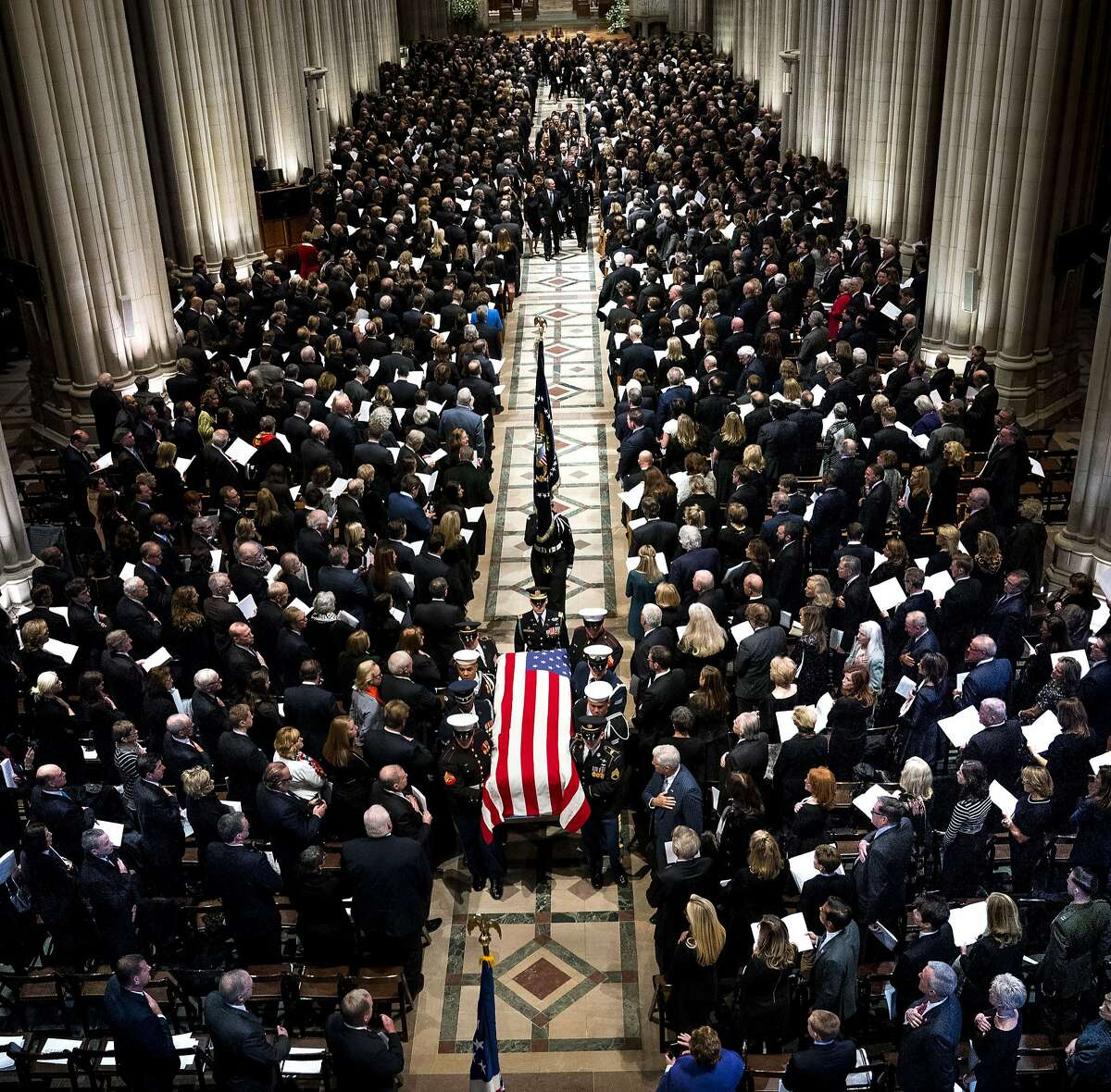 The coffin bearing the remains of former President George H.W. Bush is carried out after his funeral at the National Cathedral in Washington on Wednesday, Dec. 5, 2018.
