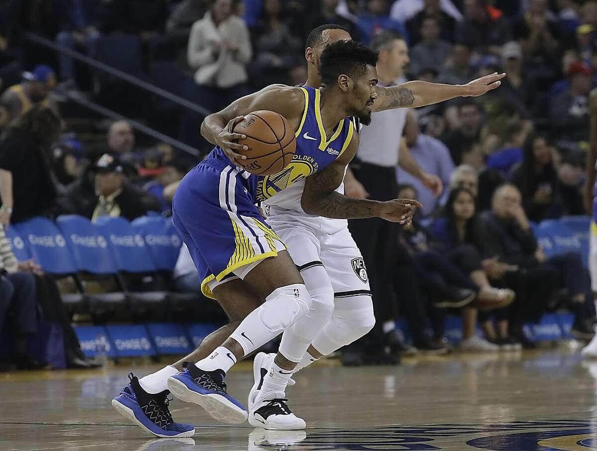 Golden State Warriors guard Jacob Evans III (10) drives against the Brooklyn Nets during the second half of an NBA basketball game in Oakland, Calif., Saturday, Nov. 10, 2018. (AP Photo/Jeff Chiu)