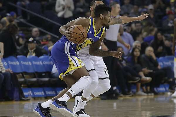 ed82e3ab0d5 1of3Golden State Warriors guard Jacob Evans III (10) drives against the  Brooklyn Nets during the second half of an NBA basketball game in Oakland