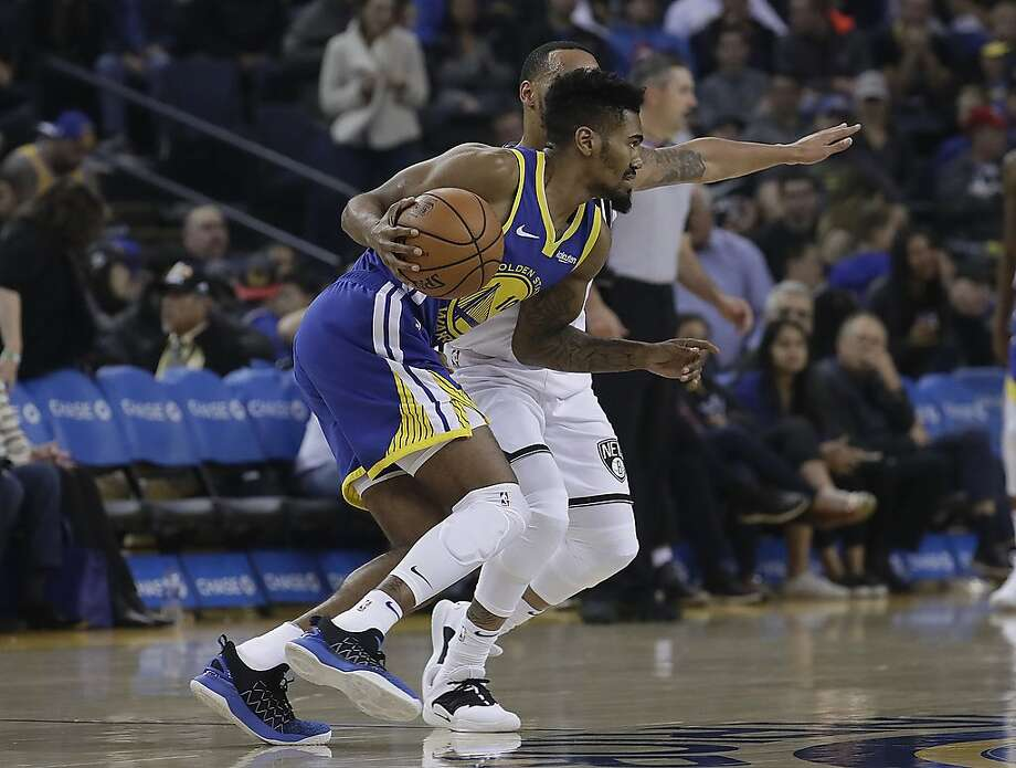 Golden State Warriors guard Jacob Evans III (10) drives against the Brooklyn Nets during the second half of an NBA basketball game in Oakland, Calif., Saturday, Nov. 10, 2018. (AP Photo/Jeff Chiu) Photo: Jeff Chiu / Associated Press