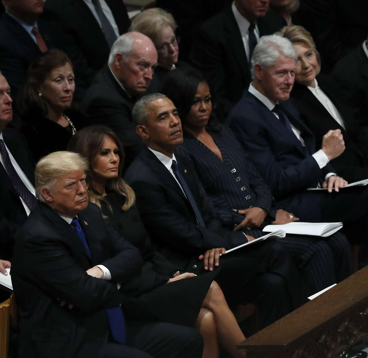 Bill Clinton pumps his fist as he reacted as Reverend Dr. Russell Levenson Jr. officiated during the State Funeral for George H.W. Bush at the Washington National Cathedral, Wednesday, Dec. 5, 2018, in Washington.