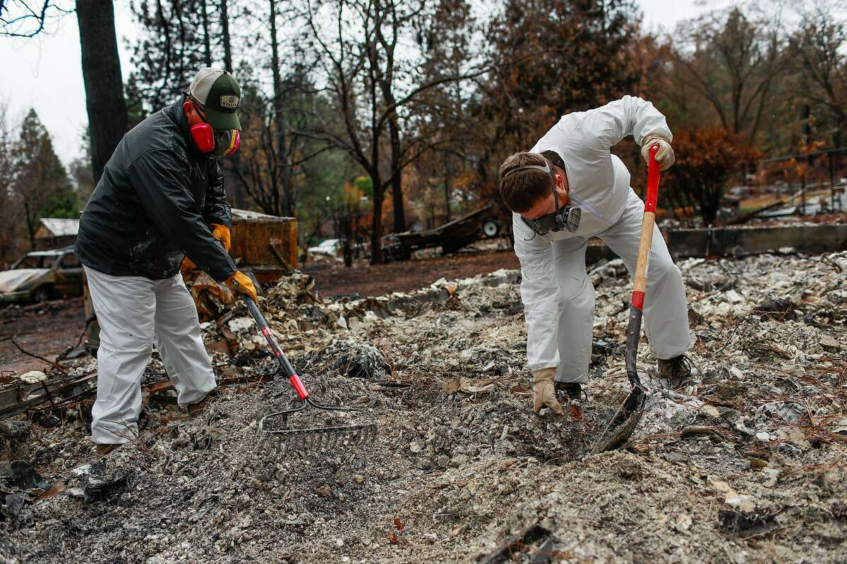 Lester Skelley,59 and son Greg Skelly, 31 dig for remaining objects at their home which was destroyed by the Camp Fire in Paradise, California, on Wednesday, Dec. 5, 2018. The area off of Pentz Road had its evacuation order lifted today.
