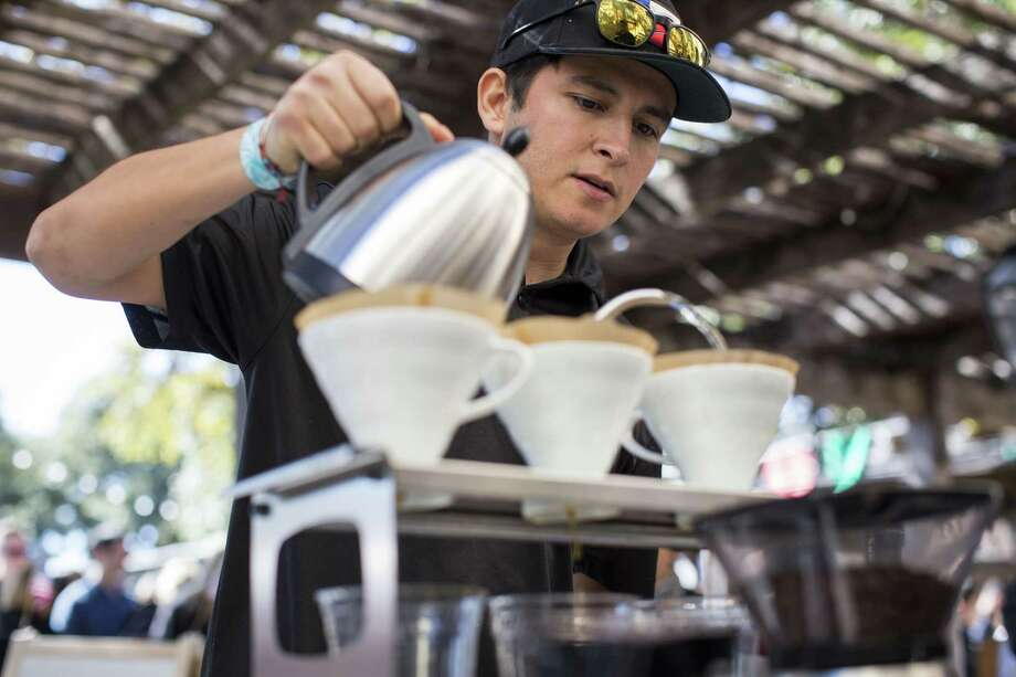 Isaac Cummings brews coffee at the Joseph E. Coffee booth during the 2015 San Antonio Coffee Festival. Photo: Staff File Photo / 2016 San Antonio Express-News