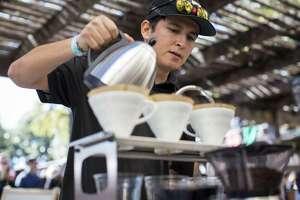 Isaac Cummings brews coffee at the Joseph E. Coffee booth during the 2015 San Antonio Coffee Festival.
