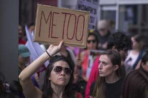 Demonstrators participate in the 2017 #MeToo Survivors' March in Los Angeles.