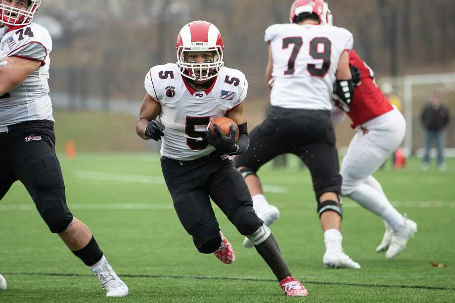 New Canaan running back J.R. Moore has rushed for 239 yards over two games in the Class LL playoffs. Photo: John McCreary / For Hearst Connecticut Media / Connecticut Post Freelance