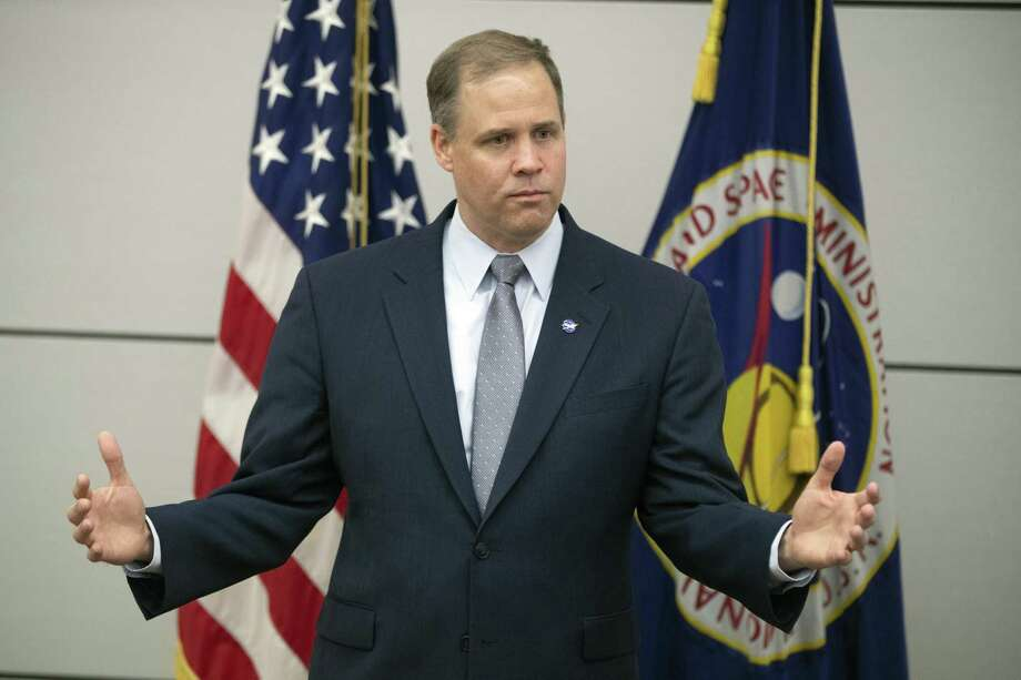 FILE - In this Oct. 12, 2018 file photo, Administrator of the National Aeronautics and Space Administration (NASA) Jim Bridenstine speaks during a news conference at the U.S. Embassy in Moscow, Russia. America's next moon landing will be made by private companies, not NASA. Bridenstine announced Thursday, Nov. 29 that nine U.S. companies will compete in delivering experiments to the lunar surface. (AP Photo/Pavel Golovkin, File) Photo: Pavel Golovkin, STF / Associated Press / Copyright 2018 The Associated Press. All rights reserved.