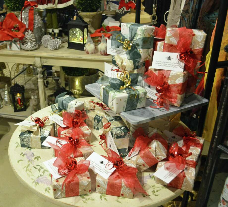 Downtown Middletown's extensive variety of small businesses make holiday gift shopping easy this season. Items shown can be purchased at the Wesleyan R.J. Julia Bookstore at 413 Main St., Ladybug Boutique at 122 Court St., A Pocketful of Posies in Main Street Market, 386 Main St., and Amato's Toy and Hobby at 395 Main St. Photo: Cassandra Day / Hearst Connecticut Media