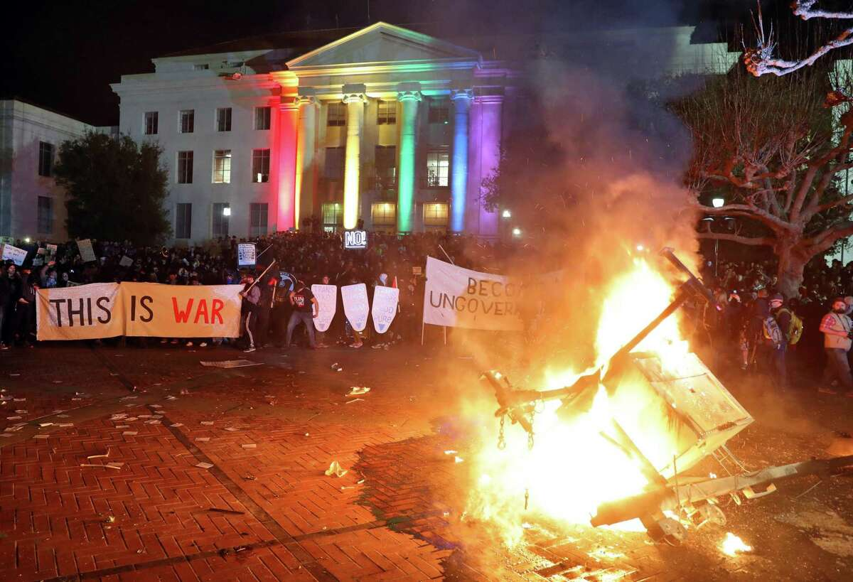 A portable light unit burns after protesters forced the cancellation of a 2017 talk by right-wing provocateur Milo Yiannopoulos at UC Berkeley in Berkeley, Calif.