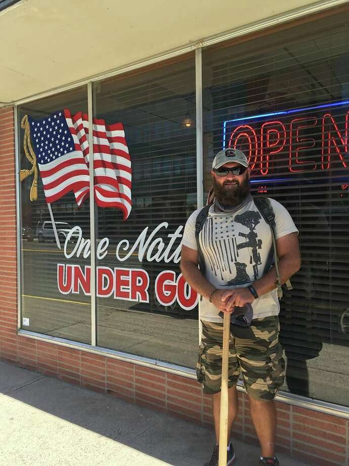 Larry Hinkle has logged more than 5,000 miles walking across the country and connecting face-to-face with veterans and first responders. One of his journeys included a stop at The Bar, where he formed connections with owner Scott Gunn and General Manager Judy Farris. Photo: Courtesy Photo