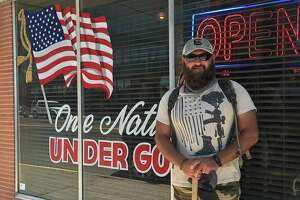 Larry Hinkle has logged more than 5,000 miles walking across the country and connecting face-to-face with veterans and first responders. One of his journeys included a stop at The Bar, where he formed connections with owner Scott Gunn and General Manager Judy Farris.