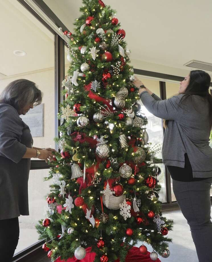 Mary Lopez and Katherine Prementine finish decorating one of the Christmas Trees in the Allison Fine Arts Building. Click through to see scenes from Christmas at the Mansion Preview Party>>> Photo: Tim Fischer/Midland Reporter-Telegram