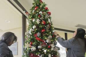 Mary Lopez and Katherine Prementine finish decorating one of the Christmas Trees 12/03/18 in the Allison Fine Arts Building. Tim Fischer/Reporter-Telegram