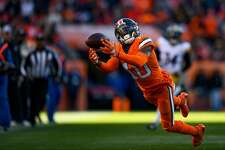DENVER, CO - NOVEMBER 25: Wide receiver Emmanuel Sanders #10 of the Denver Broncos dives for a ball on what would have been a long completion and first down against the Pittsburgh Steelers on the second quarter of a game at Broncos Stadium at Mile High on November 25, 2018 in Denver, Colorado. (Photo by Dustin Bradford/Getty Images)