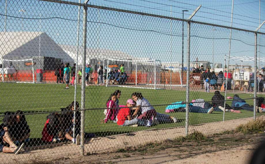In this Nov. 25, 2018 photo provided by Ivan Pierre Aguirre, migrant teens held inside the Tornillo detention camp sit inside the facility in Tornillo, Texas. The Trump administration announced in June 2018 that it would open the temporary shelter for up to 360 migrant children in this isolated corner of the Texas desert. Less than six months later, the facility has expanded into a detention camp holding thousands of teenagers - and it shows every sign of becoming more permanent. (Ivan Pierre Aguirre via AP) Photo: Ivan Pierre Aguirre / Ivan Pierre Aguirre