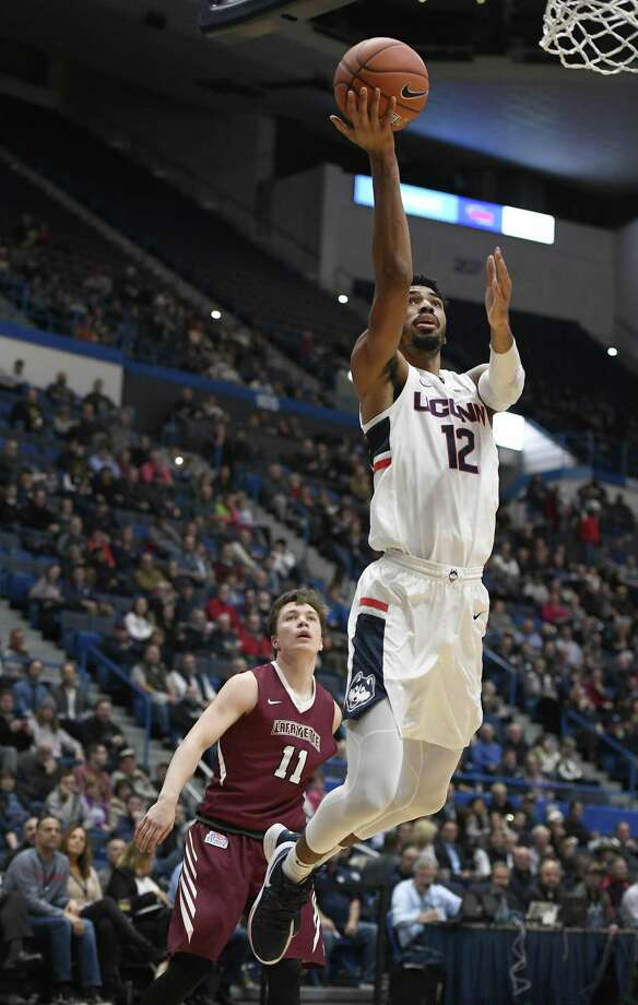 UConn's Tyler Polley (12) goes up to the basket as Lafayette's Justin Jaworski looks on during Wednesday night's game at the XL Center in Hartford. Photo: Jessica Hill / Associated Press / Copyright 2018 The Associated Press. All rights reserved