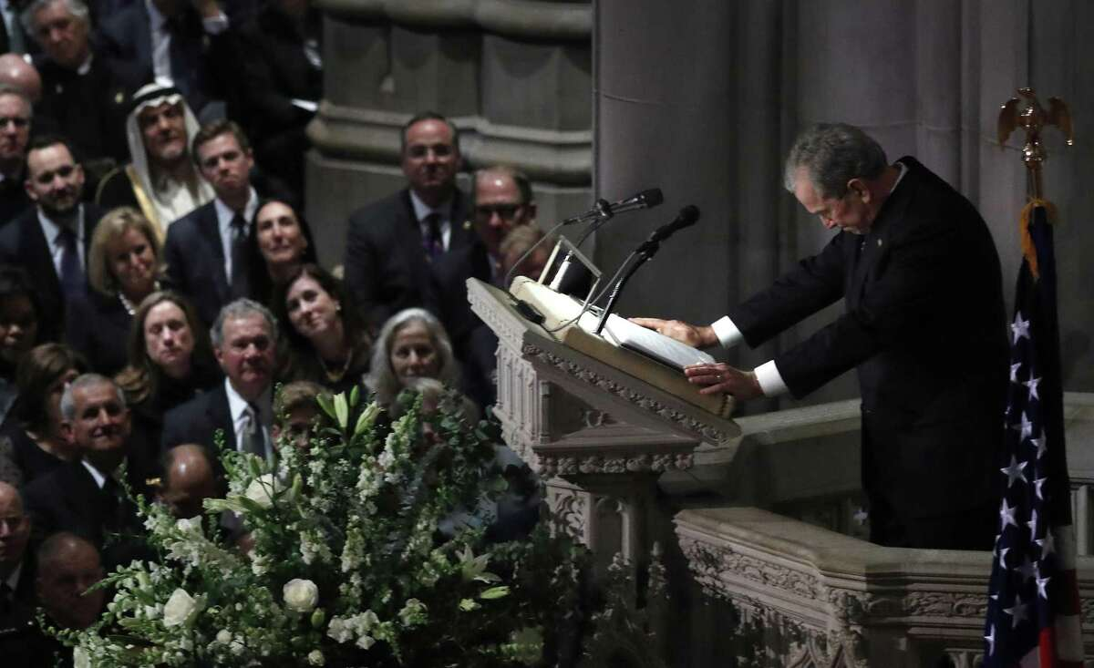 George W. Bush breaks up as he delivered a eulogy for his father during the State Funeral for George H.W. Bush at the Washington National Cathedral, Wednesday, Dec. 5, 2018, in Washington.