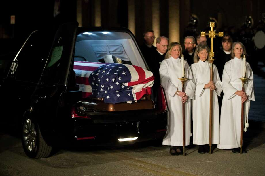 Military and civilian clergy stand by the casket of former President George H.W. Bush during the arrival ceremony at St. Martin's Episcopal Church where the former president will lie in repose, Wednesday, Dec. 5, 2018, in Houston. Photo: Marie D. De Jesús, Staff Photographer / © 2018 Houston Chronicle
